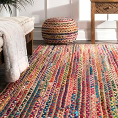 You'll love the bohemian feel of this Multi-Color Braided Jute and Cotton Area Rug! No matter where in your house, give your space an updated and colorful look.