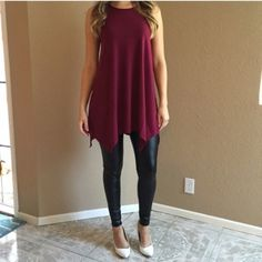 Burgundy Trapeze Sleeveless Tunic Burgundy Trapeze Sleeveless Tunic. Available in S-M-L. Brand new. Never worn. No Paypal. No trades. 10% discount on all bundles made with the bundle feature. No offers will be considered unless you use the make me an offer feature.      Please follow  Instagram: BossyJoc3y  Blog: www.bossyjocey.com Tops Tunics