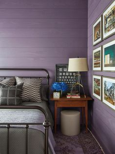 Wall color: Expressive Plum by HGTV Home by Sherwin-Williams.  Iron bed frame.