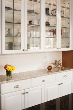 Beautifully organized glass cabinets in our Whitefish Bay Kitchen remodel www.remodelwithsaz.com