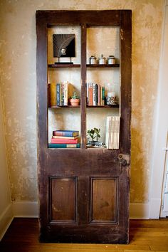 vintage door repurposed into bookshelf