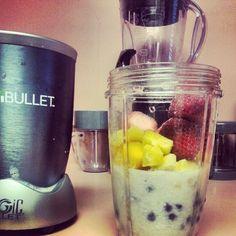 Smoooothie time. Mango pineapples bananas strawberries and blueberries #vegan #nutribullet #smoothie #raw #health #nutriblast