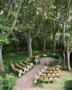The lush garden scenery at this outdoor ceremony on the property of Petit…