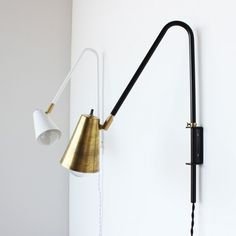 wallace wall light brass swing extendable from onefortythree.com