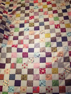 'New England Fall' quilt top completed. my current patchwork project. A zillion colorful fabrics alternated with light gray.