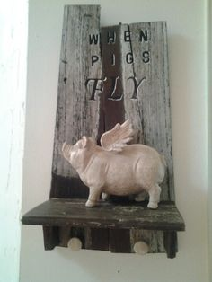 SOLD  when pigs fly shelf with 2 knobs to hang keys, ect. @Derek Smith.in b's in sharpsburg, ga. 770-253-8730. v 103, born in a barn