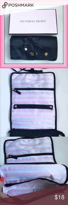Victoria's Secret Jewelry Travel Bag Black satin with pink and white satin lining. Gold VS logo on front. Interior has 1 zip pocket, 1 bigger zip pouch and ring/bracelet holder. Rolls up and ties closed keeping your jewelry organized. NEW IN BOX. 814201618 Victoria's Secret Bags