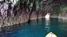 Kayaking through a cave in the cliff side of Catalina Island