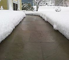 Heated tire tracks allow use of steep driveway during storms snow radiant heated driveways and snow melting systems solutioingenieria Choice Image