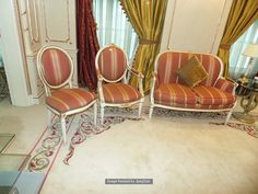 Lot 1029 - A Neoclassical salon painted and gilt suite comprising of a sofa, and a fauteuil arm chair and