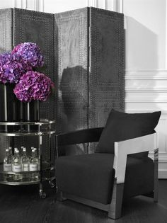 The Rubautelli Chair comprises a polished stainless steel frame and features a Panama black upholstery and cushion. ICONIC RETRO DESIGN Style your home exquisitely with the Eichholtz Rubautelli series. The iconic retro design with neutral palette wil Mini Bar, Luxury Lighting, Interior Styling, Stainless Steel Frame, Monochrome Interior, Chair, Beautiful Bars, Eichholtz, Rectangular Table Lamp