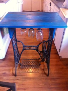 Small table with wine glass storage from old singer sewing machine legs :)