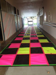 Used the giant paper roll as a base and then added poster paper from dollar store and neon duct tape to create GLO PATH