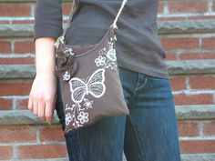 T-shirt pochette by Shiho the Craft Guru, via Flickr  This cute pochette is made by the old T-shirt.    Sometimes, it's hard to let go your favorite T-shirt even though it gets so old that you can't wear them anymore...well wear them in a different way!