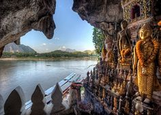 Buddha statues in lower Pak Ou Cave on the Mekong River north of Luang Prabang, Laos. (bordered by Burma and China to the northwest, Vietnam to the east, Cambodia to the south and Thailand to the west). These caves were immense! Vientiane, Luang Prabang, Laos Travel, Asia Travel, Beach Travel, Vietnam, Lao New Year, Voyage Laos, Places To See