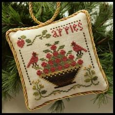 Sweet Apples is the title of this sixth cross stitch pattern from Little House Needleworks series titled 'The Sampler Tree' that is stitched with Classic Colorworks