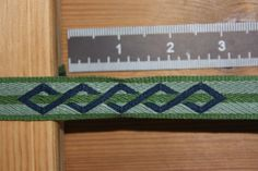 Photo Album II Although I can't read the language, this website has some great photos of card woven bands. I think that this pattern will inspire one for me on the inkle loom.