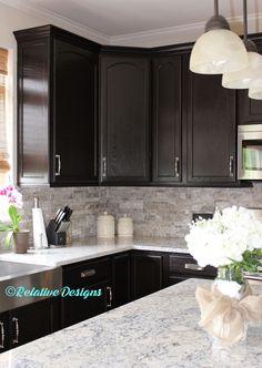 white Ice Granite Counter Tops, Travertine Ledger stone back Splash, Kohler Vault farm sink, Cabinets refinished in Java Gel.