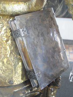 "Silver book (Detail) - ""Saint Barbara Reliquary-Bust"" (1607) by Lelio Giliberto - silver, gilded copper, gilded wood - Naples, Castel Nuovo Museum   #TuscanyAgriturismoGiratola"