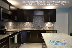 Contemporary Kitchen - Dark Walnut Cabinets with River White Granite Counter Top! Our luxurious Orange County showroom, located in beautiful Mission Viejo, is the perfect shop for all your bathroom and kitchen remodeling needs.! visit our site: http://amazingcabinetry.com/portfolio-item/contemporary-kitchen-cabinets/