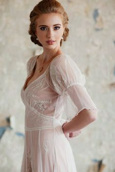 Gorgeous, delicate dress.  The hair pairs with it perfectly.
