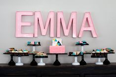 Modern Baby Shower Dessert Table - dessert on cake stands and marquee letters. Perfection!