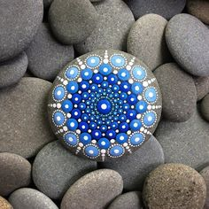 She Carefully Covers Ocean Stones With Thousands Of Tiny Dots… Her Work Is Mesmerizing.