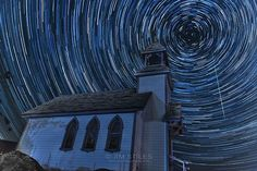 Photo courtesy of Jim Stiles. During the Perseid Meteor Showers of August, 2012 I captured a sequence of 70 individual photos, each 2 minutes long with this tiny chapel in Curlew, Washington (Ferry County). Later, I combined all 70 photos to show the rotation of the earth thus merging together the star trails. During one of the exposures I was able to capture one of the meteors.