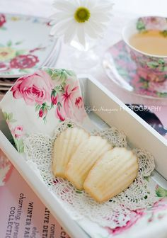 Variety of smaller cookies, displayed on lace doilie (paper) & delicate ornate plate at each table