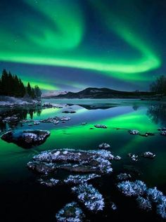 See the northern lights in Alaska. The aurora borealis lights up the sky with green bands that are actually solar particles in the earth's magnetic field.