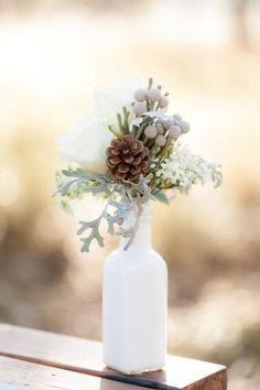 Simple and beautiful winter pinecone wedding centerpiece. DIY winter wedding or home decor.