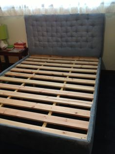 Homemade platform bed with tuffed headboard.. made it with the help from pinterest and we love it!!! Made with Love :)