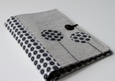 cute notepad organizer (Notepad Holder Organizer, List Taker -- Black and Gray Ovals and Linen. $25.00 via Etsy.)