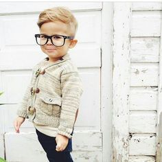 Short and round. It's a comfy style for your kid. The blonde hair of the toddler adds grace to the short and round haircut.