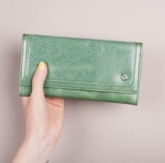 A personal favorite from my Etsy shop https://www.etsy.com/listing/211870449/woman-leather-wallet-trifold-sea