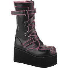 Hip platform boots featuring a high platform, a side zipper and multiple adjustable straps.
