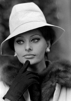 Sophia Loren is picture perfect. Hat, pearls, gloves and fur scarf, what more could a stylish women want.