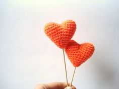 Psh, I could MAKE these. In any color I want!  Crochet Hearts Cake Topper | 27 Ideas For Adorable And Unexpected Wedding Cakes