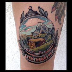 Beautiful little mountain scene snow globe tattoo by Brian Povak