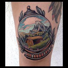 Beautiful little mountain scene snow globe tattoo by Brian Povak