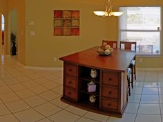 Enjoy dining at either the kitchen nook, or the formal dining area. (Picture:  Kitchen nook with chairs and stools.)