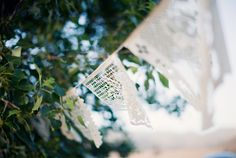 beautiful lace bunting they also used garland and strands of lights for this outdoor wedding that was PERFECT