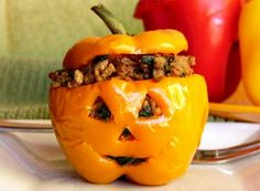 So cute and fun! Halloweegan Peppers: Vegan Quinoa Filling in Carved Squash or Bell Peppers! | Go Dairy Free