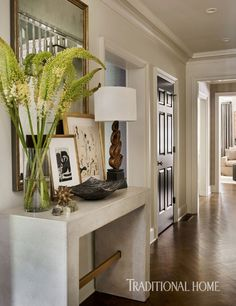 In the foyer, a stone table interjects modern texture. - Photo: Emily Jenkins Followill / Design: Courtney Giles