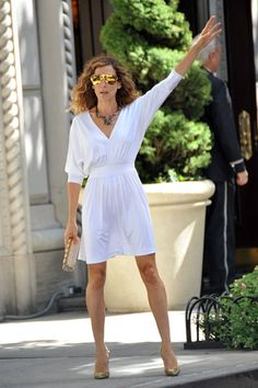 Carrie Bradshaw - Halston Heritage Dress, Mykita & Bernard Willhelm's Franz Limited-Edition Aviator Sunglasses, Solange Azagury-Partridge Necklace, Christian Louboutin Pigalle Gold Sequined Pumps, and Chanel Clutch