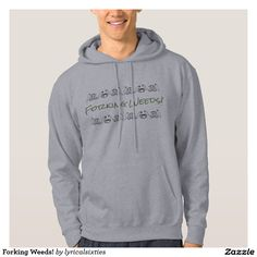 """Forking Weeds! Hoodie.  This lovely warm hoodie for him to wear while gardening has the words, in olive green, """"FORKING WEEDS!"""" and is decorated with a frieze of vegetables in black outline."""