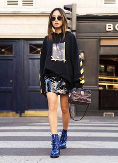 Patent leather miniskirt + graphic sweatshirt + combat boots