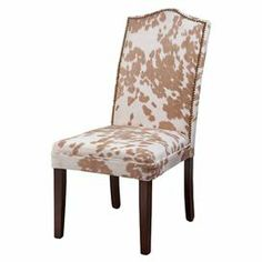 """Hardwood side chair with cowhide-patterned upholstery and nailhead trim.  Product: ChairConstruction Material: Solid hardwood and microfiber-polyester blendColor: Tan and whiteFeatures:  Stain resistant seatNailhead trim Dimensions: 44"""" H x 20"""" W x 18"""" D"""