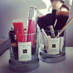 Clean out candle glasses and reuse them for makeup brushes etc.
