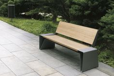 Contemporary public bench in wood and metal (with backrest) RADIUM by David Karásek, Radek Hegmon mmcité 1 a.s.